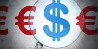 lupa sobre el dólar